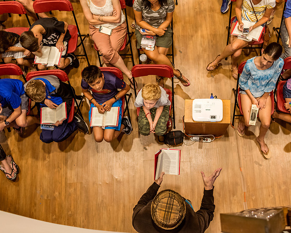 July 26, 2017. Raleigh, North Carolina.<br /> <br /> The gathered crowd listens as Alan Gratz reads from his new book &quot;Refugee&quot;.<br /> <br /> Author Alan Gratz spoke about and signed his new book &quot;Refugee&quot; at Quail Ridge Books. The young adult fiction novel contrasts the stories of three refugees from different time periods, a Jewish boy in 1930's Germany , a Cuban girl in 1994 and a Syrian boy in 2015.