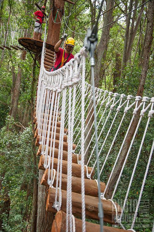 Walking between platforms while Ziplining on the Big island with Kohala zipline
