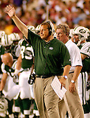 Landover, MD - August 19, 2006 -- New York Jets head coach Eric Mangini calls a play during the preseason action against the  Washington Redskins at FedEx Field in Landover, Maryland, Saturday, August 19, 2006.<br />
