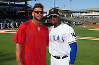 Surprise Saguaros Yoan Moncada (10), of the Boston Red Sox organization, poses for a photo with Andy Ibanez (1), of the Texas Rangers organization, before a game against the Glendale Desert Dogs on October 22, 2016 at Surprise Stadium in Surprise, Arizona.  Both prospects are from Cuba.  Surprise defeated Glendale 10-8.  (Mike Janes/Four Seam Images)