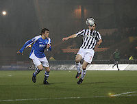John McGinn gets the better of Murray Davidson in the St Mirren v St Johnstone Clydesdale Bank Scottish Premier League match played at St Mirren Park, Paisley on 8.12.12.