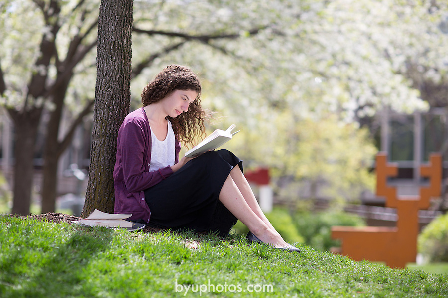 1304-63 050 GCI Riana Portrait<br /> <br /> Portrait of student Riana Culp in the MOA Museum of Art Garden, Reading, Studying, Spring<br /> <br /> April 30, 2013<br /> <br /> Photo by Jonathan Hardy/BYU Photo<br /> <br /> &copy; BYU PHOTO 2013<br /> All Rights Reserved<br /> photo@byu.edu  (801)422-7322