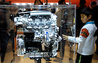 A Chinese boy is attracted by an engine of Volkswagen at the 9th Beijing International Automotive Exhibition in Beijing, China..19 Nov 2006