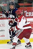Trevor van Riemsdyk (UNH - 6), Marshall Everson (Harvard - 21) - The Harvard University Crimson defeated the University of New Hampshire Wildcats 7-6 on Tuesday, November 22, 2011, at Bright Hockey Center in Cambridge, Massachusetts.