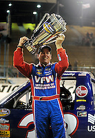 Nov. 13, 2009; Avondale, AZ, USA; NASCAR Camping World Truck Series driver Ron Hornaday celebrates after clinching the 2008 championship following the Lucas Oil 150 at Phoenix International Raceway. Mandatory Credit: Mark J. Rebilas-