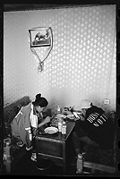 Lhasa, Tibet, China - Tibetan youths enjoy using their mobile phones at an old tea house in Lhasa, Tibet, September 2018.
