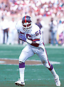 New York Giants Lawrence Taylor (56) in action during a game against the Chicago Bears on September 15, 1991at Soldier Field in Chicago, Illinois. The Bears beat the Giants 20-17. Lawrence Taylor was inducted to the Pro Football Hall of Fame in 1999.