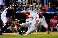 April 11, 2009: Phillies first baseman Ryan Howard slides into home ahead of the tag by Rockies catcher Yorvit Torrealba during a game between the Philadelphia Phillies and the Colorado Rockies at Coors Field in Denver, Colorado. The Phillies beat the Rockies 8-4.