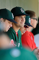 Designated hitter Michael Chavis (11) of the Greenville Drive watches the action from the dugout during a game against the Charleston RiverDogs on Sunday, June 28, 2015, at Fluor Field at the West End in Greenville, South Carolina. Chavis was a first-round pick of the Boston Red Sox in the 2014 First-Year Player Draft. Charleston won, 12-9. (Tom Priddy/Four Seam Images)