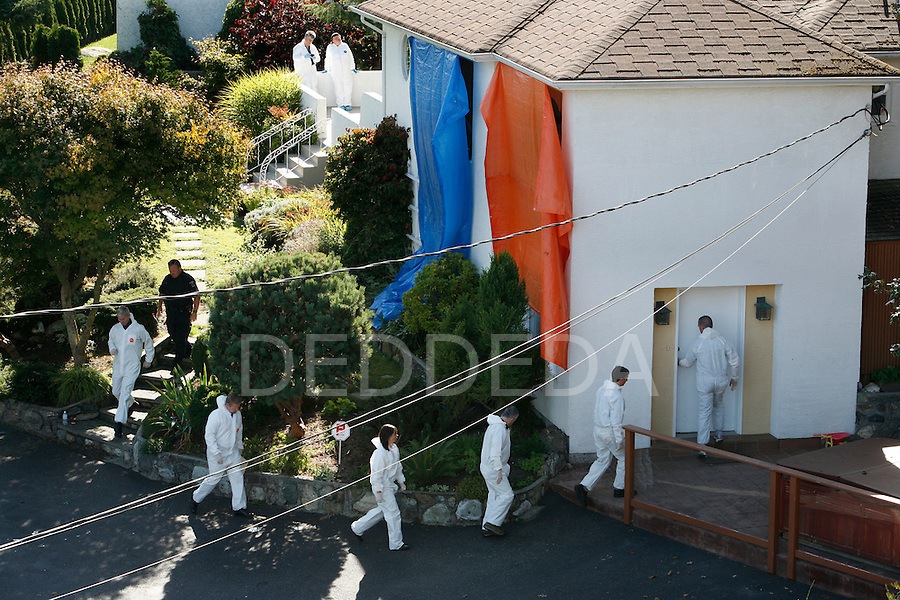 Coroners and police enter the house at 310 King George Terrace in Oak Bay, BC, near Victoria, where five people are confirmed dead in a murder/suicide situation near Victoria, British Columbia. Photo assignment for the Globe and Mail national newspaper in Canada.