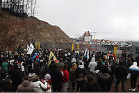 Skouries, Greece Sunday 23 November 2014<br /> Pictured: Hundreds of protesters outside Eldorado's mine.<br /> Re: Riot police called to break up a protest by local residents against a Canadian-run goldmine in Skouries, in the Chalkidiki area. Eldorado firm has been accused of dumping toxic waste generated during gold processing in northern Greece, into local rivers. Teargas was used by the police to disperse the protesters who retaliated with pyrotechnics.