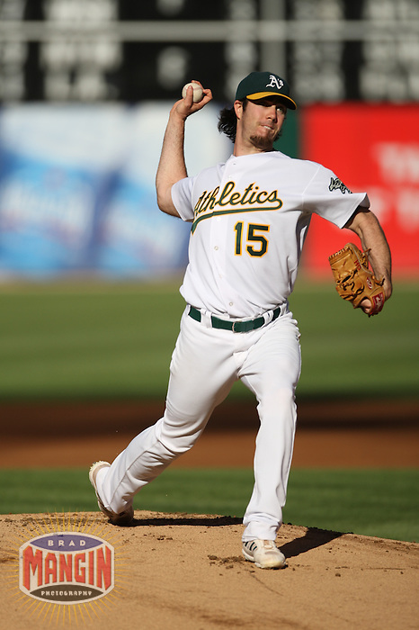 OAKLAND, CA - July 21:  Dan Haren of the Oakland Athletics pitches during the game against the Baltimore Orioles at the McAfee Coliseum in Oakland, California on July 21, 2007.  The Athletics defeated the Orioles 4-3.  Photo by Brad Mangin