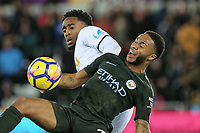 (L-R) Leroy Fer of Swansea City challenges Raheem Sterling of Manchester City during the Premier League match between Swansea City and Manchester City at The Liberty Stadium, Swansea, Wales, UK. Wednesday 13 December 2017