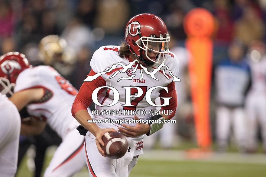 NOV 10, 2012: Utah quarterback #7 Travis Wilson sets up to hand the ball off against Washington.  Washington won 34-15 over Utah at CenturyLink Field in Seattle, WA...