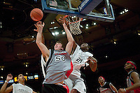 Eric Boateng (#21) fight for the ball with Tyler Hansbrough (#50) during the Jordan Classic game at Madison Square Garden in New York City, United States, 16 April 2005.