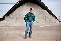 Leighton Stovall (cq), manager of the Moore County Cotton Gin, stands in front of a barn full of cotton seed in Dumas, Texas, Monday, February 14, 2011. With the high price of cotton in recent years, many farmers in the area have switched to start farming cotton...Photo by Matt Nager