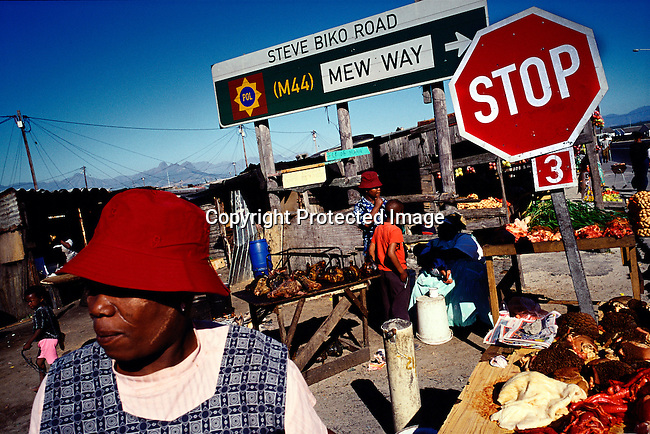Women sell traditional food such as grilled sheep heads and cow intestines, in Khayelitsha, the largest and poorest black township outside Cape Town, South Africa.  (Photo by: Per-Anders Pettersson)