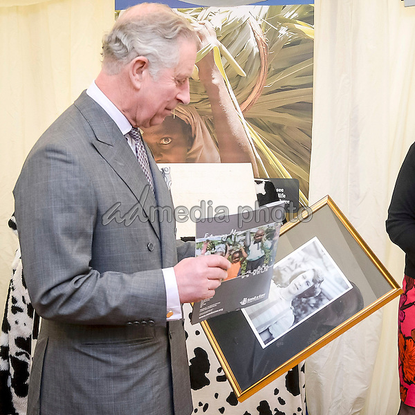 01 February 2016 - London, England - Prince Charles The Prince of Wales shares a joke with with Uganda Director Patrick Sambaga (left) of international development charity Send a Cow's headquarters in Newton St Loe, Bath. Send a Cow works in seven countries in Africa, providing some of the continent's poorest people with training, tools, seeds and livestock to help lift themselves out of poverty. Photo Credit: Alpha Press/AdMedia