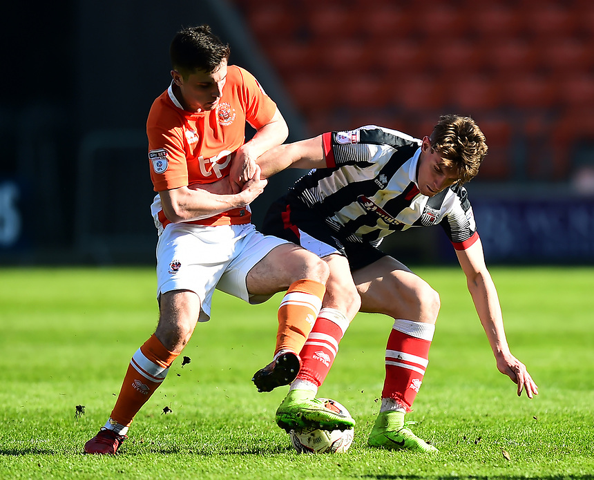 Blackpool's Jordan Flores battles with Grimsby Town's Sam Jones<br /> <br /> Photographer Richard Martin-Roberts/CameraSport<br /> <br /> The EFL Sky Bet League Two - Blackpool v Grimsby Town - Saturday 8th April 2017 - Bloomfield Road - Blackpool<br /> <br /> World Copyright &copy; 2017 CameraSport. All rights reserved. 43 Linden Ave. Countesthorpe. Leicester. England. LE8 5PG - Tel: +44 (0) 116 277 4147 - admin@camerasport.com - www.camerasport.com
