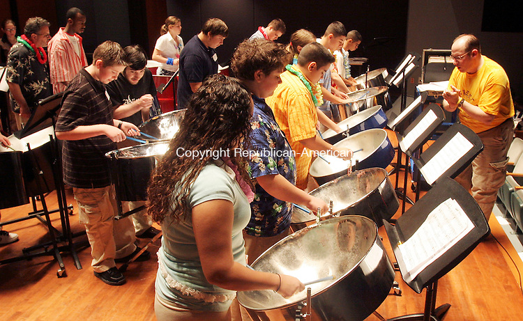 WATERBURY, CT-16November 2006-111606TK03- (left to right) Waterbury Arts Magnet School students rehearsed with the Jim Royle's Caribbean Steelpan ensemble , from Fairfield, before a performance Thursday night at the Palace Theater. Jim Royle(right), director for the ensemble, leads the rehearsal. Tom Kabelka Republican-American (Jim Royle's)