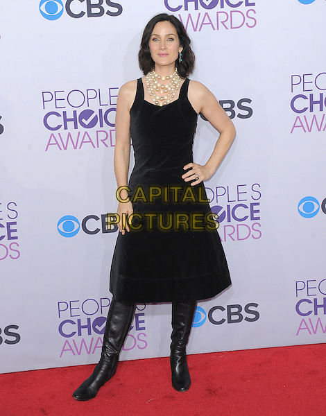 Carrie Anne Moss.The 2013 People's Choice Awards held at Nokia Live in Los Angeles, California 9th January 2013                                                                   .full length dress boots black sleeveless pearls necklace hand on hip.CAP/DVS.©DVS/Capital Pictures.