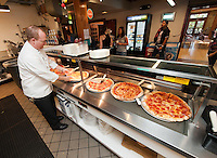 Cooks make pizzas and other food Inside the Occidental College Samuelson Campus Pavilion, also known as The Cooler. April 8, 2010. (Photo by Marc Campos, Occidental College Photographer)