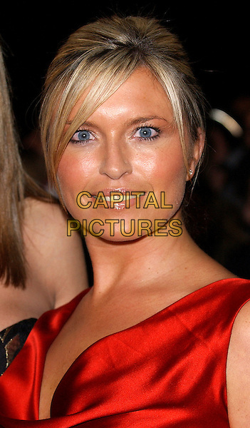 TINA HOBLEY.National TV Awards, 2004 at The Royal Albert Hall..October 26th, 2004.headshot, portrait, orange, tan.www.capitalpictures.com.sales@capitalpictures.com.© Capital Pictures.
