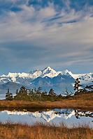 Port Wells, Mt Gilbert of the Chugach mountains reflects in a tundra pond, Chugach National Forest, Prince William Sound, southcentral, Alaska.