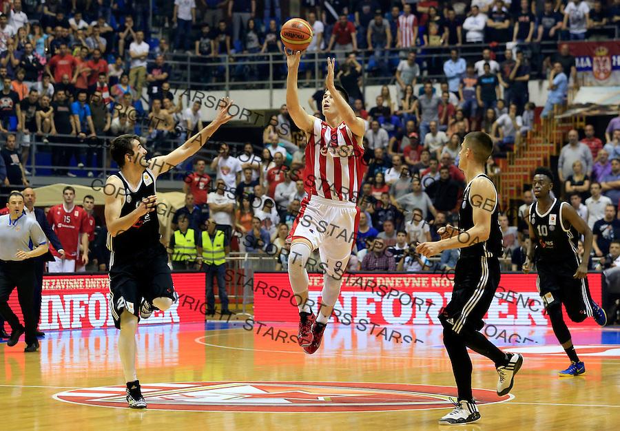 Kosarka Kosarkaska Liga Srbije season 2014-2015<br /> Crvena Zvezda v Partizan<br /> Luka Mitrovic (C) Vanja Marinkovic (R) and Mihajilo Andric (L)<br /> Belgrade, 05.17.2015.<br /> foto: Srdjan Stevanovic/Starsportphoto &copy;