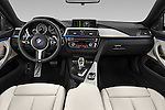 Stock photo of straight dashboard view of 2015 BMW 4 Series 435i Gran Coupe 5 Door Hatchback Dashboard