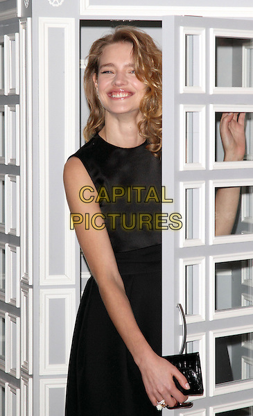 Natalia Vodianova .at a photocall to launch Dior at Harrods, at the Harrods Georgian Restaurant, Knightsbridge, London, England, .March 14th 2013..half length door smiling  black dress sleeveless telephone phone box phonebox.CAP/ROS.©Steve Ross/Capital Pictures.