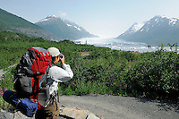 Georgia Bennett stops for a photo along the trail to Spencer Glacier. The Alaska Railroad's Spencer Glacier Whistlestop train gives visitors access to hiking, camping and stunning views.