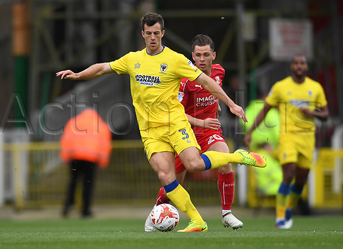April 14th 2017, County Ground, Swindon, Wiltshire; Skybet league 1 football, Swindon Town versus AFC Wimbledon; Jonathan Meades, defender AFC Wimbledon clears the ball downfield