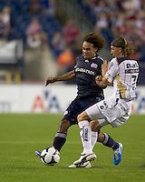 Pumas UNAM midfielder Leandro Augusto (7) fouls advancing New England Revolution defender Kevin Alston (30). The New England Revolution defeated Pumas UNAM in SuperLiga group play, 1-0, at Gillette Stadium on July 14, 2010.