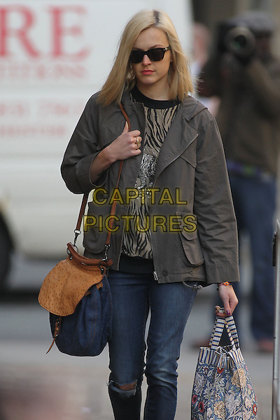 Fearne Cotton in central London, England..March 26th, 2012.half 3/4 length jeans denim ripped torn beige top grey gray jacket sunglasses shades bag blue.CAP/HIL.©John Hillcoat/Capital Pictures .