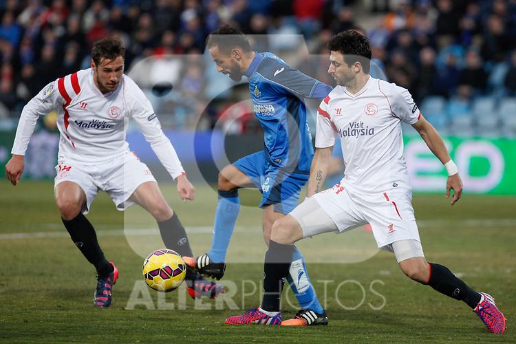 Getafe´s Diego Castro and Sevilla´s Arribas and Krychowiak during 2014-15 La Liga match at Alfonso Perez Coliseum stadium in Getafe, Spain. February 08, 2015. (ALTERPHOTOS/Victor Blanco)