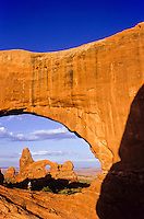 Window Rock and Turret arch at sunrise in Arches Natioal Monument in Utah