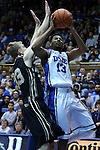 30 November 2014: Duke's Matt Jones (13) and Army's Larry Toomey (33). The Duke University Blue Devils hosted the West Point Military Academy Army Black Knights at Cameron Indoor Stadium in Durham, North Carolina in a 2014-16 NCAA Men's Basketball Division I game. Duke won the game 93-73.
