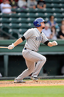 First baseman Sean Dwyer (27) of the Asheville Tourists bats in a game against the Greenville Drive on Friday, April 24, 2015, at Fluor Field at the West End in Greenville, South Carolina. Greenville won, 5-2. (Tom Priddy/Four Seam Images)
