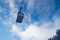 cable car passing overhead in Swiss Alps