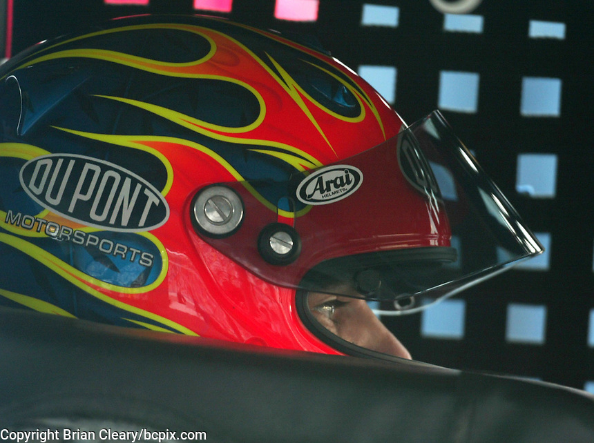Jeff Gordon sits in his car during a practice session for the Pop Secret 400 NASCAR Winston Cup race at Rockingham, NC on Saturday, November 8, 2003. (Photo by Brian Cleary)