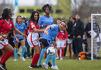 Lauryn Goodman shields the ball from Natasha Olrog (Music Group PYT (Pretty Young Thing) while Naomi (Ex On the Beach) looks on during the SOCCER SIX Celebrity Football Event at the Queen Elizabeth Olympic Park, London, England on 26 March 2016. Photo by Andy Rowland.