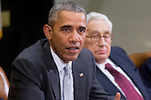 United States President Barack Obama, left, speaks while meeting with current and former diplomatic and national security officials including Henry Kissinger, former U.S. Secretary of State, to discuss the Trans-Pacific Partnership (TPP) in the Roosevelt Room of the White House in Washington, D.C., U.S., on Friday, November 13, 2015. Obama, hoping to kick off a new phase of selling the TPP at home while enhancing its prospects overseas, has enlisted some of the nation's top national security leaders to give testimonials. <br /> Credit: Andrew Harrer / Pool via CNP