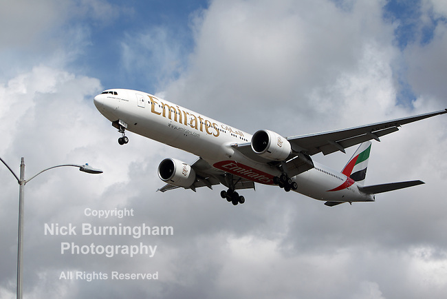 LOS ANGELES, CALIFORNIA, USA - MARCH 8, 2013 -  Emirates Boeing 777-31HER lands at Los Angeles Airport on March 8, 2013. The plane has the most powerful jet engines in commercial service