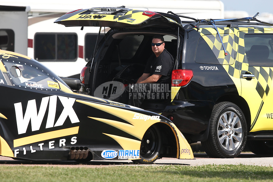 Apr. 26, 2013; Baytown, TX, USA: NHRA crew member for funny car driver Tony Pedregon during qualifying for the Spring Nationals at Royal Purple Raceway. Mandatory Credit: Mark J. Rebilas-