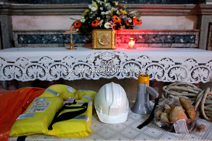 """Isola del Giglio, Italy_24/01/2012: COSTA CONCORDIA DISASTER .Items used in the rescue operation are placed on the altar as offerings..The Costa Concordia, which was carrying more than 4,000 passengers, ran aground a few hundred metres from the tiny Tuscan holiday island of Giglio on the evening of 13/01/2012 as the passengers were at dinner, after apparently sailing off course..Captain Francesco Schettino is under house arrest pending an investigation into the cause of the accident..Mandatory Credit Photo: ©Folgoso/NEWSPIX INTERNATIONAL..**ALL FEES PAYABLE TO: """"NEWSPIX INTERNATIONAL""""**..IMMEDIATE CONFIRMATION OF USAGE REQUIRED:.Newspix International, 31 Chinnery Hill, Bishop's Stortford, ENGLAND CM23 3PS.Tel:+441279 324672  ; Fax: +441279656877.Mobile:  07775681153.e-mail: info@newspixinternational.co.uk"""