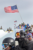 USA, California, Mammoth, crowd members watch as skiers and snoboarders compete in the halfpipe at Mammoth Ski Resort