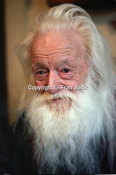 A local Icon in his nineties, vermonter Ernest Earle Sr smiles at the camera through his long white beard.