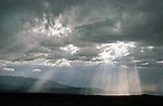 Sun pillars break through the clouds.