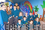 MURAL: Pupils at the Nagle-Rice national school in Milltown who have completed a colourful new mural on the wall of the school's bicycle shed with local artist Martina Felkel.